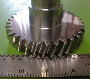 Gear and shaft with isotropic finish developed from centrifugal barrel finish operation