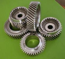 Drive train truck gears centrifugally finished for isotropic surface effect